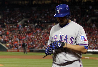ST LOUIS, MO - OCTOBER 20:  Nelson Cruz #17 of the Texas Rangers walks back to the dugout after striking out in the fifth inning in Game Two of the MLB World Series against the St. Louis Cardinals at Busch Stadium on October 20, 2011 in St Louis, Missouri