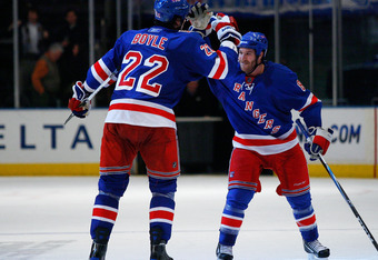 NEW YORK , NY - JANUARY 13: Brian Boyle #22 and Brandon Prust #8 of the New York Rangers high five each opther after the Rangers shutout the Vancouver Canucks at Madison Square Garden on January 13, 2011 in New York City. (Photo by Andy Marlin/Getty Image
