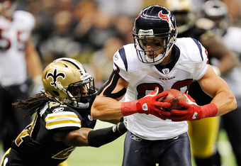 NEW ORLEANS, LA - SEPTEMBER 25:  Patrick Robinson #21 of the New Orleans Saints attempts to tackle  Kevin Walter #83 of the Houston Texans during a game being held at the Louisiana Superdome on September 25, 2011 in New Orleans, Louisiana.  (Photo by Stac