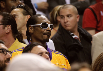 March 10, 2011: Rapper Snoop Dogg attends a Lakers-Heat game in South Beach.