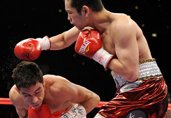 LAS VEGAS, NV - FEBRUARY 19:  Nonito Donaire (R) of the Philippines throws a right at Fernando Montiel of Mexico in the second round of their WBC/WBO bantamweight championship bout at the Mandalay Bay Events Center February 19, 2011 in Las Vegas, Nevada.