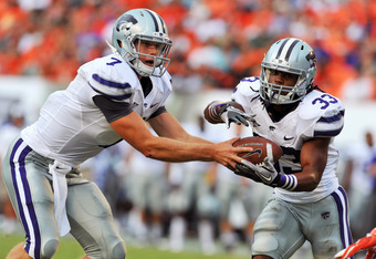 MIAMI GARDENS, FL - SEPTEMBER 24:  Quarterback Collin Klein #7  of the Kansas State University Wildcats hands off to running back John Hubert #33 against the Miami Hurricanes September 24, 2011 at Sun Life Stadium in Miami Gardens, Florida.  (Photo by Al