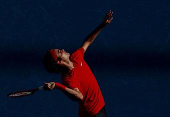 NEW YORK, NY - SEPTEMBER 10:  Roger Federer of Switzerland serves against Novak Djokovic of Serbia during Day Thirteen of the 2011 US Open at the USTA Billie Jean King National Tennis Center on September 10, 2011 in the Flushing neighborhood of the Queens