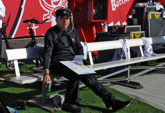 TAMPA, FL - OCTOBER 16:  Coach Sean Payton of the New Orleans Saints directs play from the bench after injuring his leg in a sideline collision against the Tampa Bay Buccaneers October 16, 2011 at Raymond James Stadium in Tampa, Florida. (Photo by Al Mess
