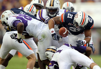 Auburn return specialist Tre Mason fumbles after being whalloped by LSU special teams