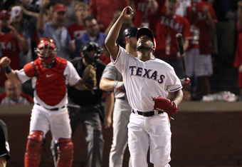 ARLINGTON, TX - OCTOBER 23: Neftali Feliz #30 of the Texas Rangers celebrates after defeating the St. Louis Cardinals 4-0 in Game Four of the MLB World Series at Rangers Ballpark in Arlington on October 23, 2011 in Arlington, Texas.  (Photo by Ezra Shaw/G