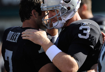 OAKLAND, CA - OCTOBER 23: Carson Palmer #3 of the Oakland Raiders talks with Kyle Boller #7 against the Kansas City Chiefs at O.co Coliseum on October 23, 2011 in Oakland, California. The Chiefs won the game 28-0. (Photo by Thearon W. Henderson/Getty Imag