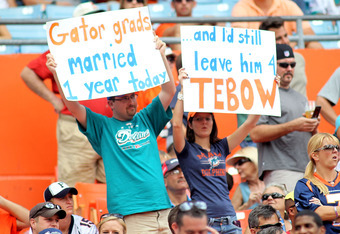 MIAMI GARDENS, FL - OCTOBER 23: Fans of  Quarterback Tim Tebow #15 of the Denver Broncos cheer against the Miami Dolphins at Sun Life Stadium on October 23, 2011 in Miami Gardens, Florida.  (Photo by Marc Serota/Getty Images)