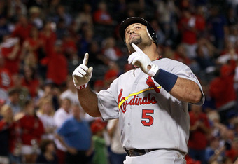 ARLINGTON, TX - OCTOBER 22:  Albert Pujols #5 of the St. Louis Cardinals hits a solo home run in the ninth inning for his third home run of the night during Game Three of the MLB World Series against the Texas Rangers at Rangers Ballpark in Arlington on O