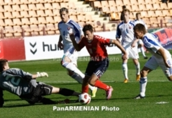 Armenia's Hovhannes Hovhannisyan of Armenia gets past the keeper to score against Slovakia