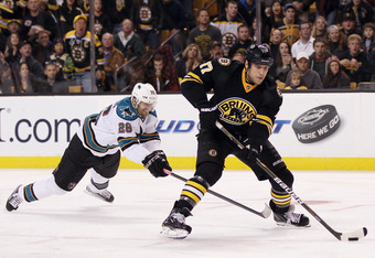 BOSTON, MA - OCTOBER 22:  Milan Lucic #17 of the Boston Bruins skates towards the net as Michal Handzus #26 of the San Jose Sharks defends on October 22, 2011 at TD Garden in Boston, Massachusetts. The San Jose Sharks defeated the Boston Bruins 4-2.  (Pho