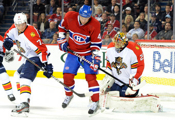 MONTREAL, CANADA - OCTOBER 24:  Andrei Kostitsyn #46 of the Montreal Canadiens attempts to deflect the puck in front of Jacob Markstrom #25 of the Florida Panthers during the NHL game at the Bell Centre on October 24, 2011 in Montreal, Quebec, Canada.  (P