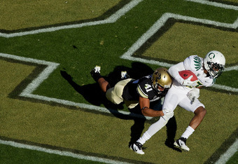 BOULDER, CO - OCTOBER 22:  Defensive back Terrel Smith #41 of the Colorado Buffaloes tackles punt returner Cliff Harris #13 of the Oregon Ducks for a safety during the third quarter at Folsom Field on October 22, 2011 in Boulder, Colorado. Oregon defeated