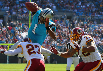 CHARLOTTE, NC - OCTOBER 23: Cam Newton #1 of the Carolina Panthers attempts to score a touchdown against DeAngelo Hall #23 and Stephen Bowen #72 both of the Washington Redskins at the Bank of America Stadium on October 23, 2011 in Charlotte, North Carolin