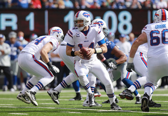 EAST RUTHERFORD, NJ - OCTOBER 16:  Ryan Fitzpatrick #14 of the Buffalo Bills passes against the New York Giants at MetLife Stadium on October 16, 2011 in East Rutherford, New Jersey.  (Photo by Nick Laham/Getty Images)