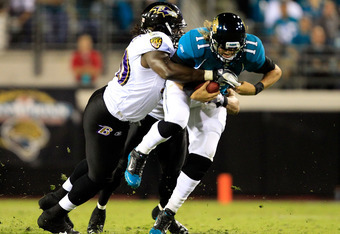 JACKSONVILLE, FL - OCTOBER 24:   Pernell McPhee #90 of the Baltimore Ravens tackles  Blaine Gabbert #11 of the Jacksonville Jaguars during the game at EverBank Field on October 24, 2011 in Jacksonville, Florida.  (Photo by Sam Greenwood/Getty Images)