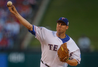 ARLINGTON, TX - OCTOBER 30:  Starting pitcher Colby Lewis #48 of the Texas Rangers pitches against the San Francisco Giants in Game Three of the 2010 MLB World Series at Rangers Ballpark in Arlington on October 30, 2010 in Arlington, Texas.  (Photo by Bri