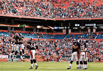 MIAMI GARDENS, FL - OCTOBER 23:  Quarterback Tim Tebow #15 of the Denver Broncos celebrates a touchdown with tweamates after scoring against the Miami Dolphins at Sun Life Stadium on October 23, 2011 in Miami Gardens, Florida. Denver defeated Miami 18-15.