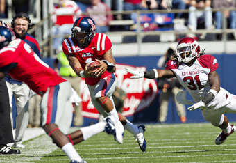 OXFORD,  MS - OCTOBER 22:  Quarterback Randall Mackey #1 of the Ole Miss Rebels gets pushed out of bounds after a getting a first down by Jerico Nelson #31 of the Arkansas Razorbacks at Vaught-Hemingway Stadium on October 22, 2011 in Oxford, Mississippi.