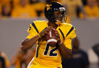 MORGANTOWN, WV - SEPTEMBER 24: Geno Smith #12 of the West Virginia Mountaineers drops back to pass against the Louisiana State University Tigers during the game on September 24, 2011 at Mountaineer Field in Morgantown, West Virginia.  (Photo by Jared Wick