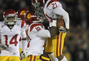 SOUTH BEND, IN - OCTOBER 22: Nickell Robey #21 of the University of Southern California Trojans is lifted into the air by Dion Bailey #18 after intercepting a pass against the Notre Dame Fighting Irish at Notre Dame Stadium on October 22, 2011 in South Be