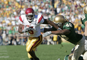 Reggie Bush of the USC Trojans runs for yardage against the Notre Dame Irish at Notre Dame Stadium in South Bend, Indiana on October 15, 2005.  USC won 34-31. (Photo by G. N. Lowrance/Getty Images)