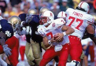 9 Sep 2000:  Quarterback Eric Crouch #7 of the Nebraska Cornhuskers defends the ball during the game against the Notre Dame Fighting Irish at the Notre Dame Stadium in South Bend, Indiana. The Cornhuskers defeated the Fighting Irish 27-24Mandatory Credit: