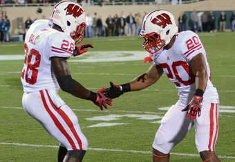 EAST LANSING, MI - OCTOBER 22:  Montee Ball #28 and James White #20 of the Wisconsin Badgers shake hands after Ball scored a touchdown in the first quarter of the game against the Michigan State Spartans at Spartan Stadium on October 22, 2011 in East Lans