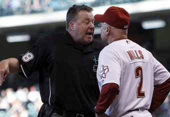 How would expanded instant replay impact the classic umpire-manager argument?
