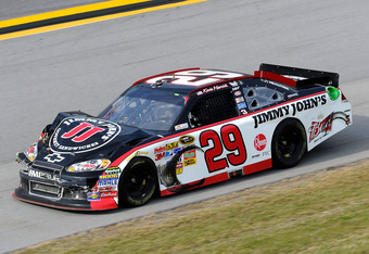 TALLADEGA, AL - OCTOBER 23:  Kevin Harvick, driver of the #29 Jimmy John's Chevrolet, drives with damage to his car during the NASCAR Sprint Cup Series Good Sam Club 500 at Talladega Superspeedway on October 23, 2011 in Talladega, Alabama.  (Photo by John