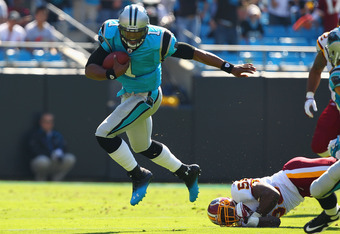 Cam Newton (1) runs for a big gain against the Washington Redskins