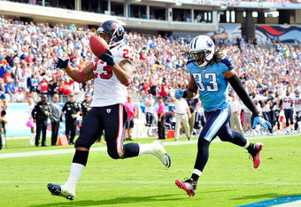 NASHVILLE, TN - OCTOBER 23:  Arian Foster #23 of the Houston Texans outruns Michael Griffin #33 the Tennessee Titans for a touchdown during play at LP Field on October 23, 2011 in Nashville, Tennessee.  (Photo by Grant Halverson/Getty Images)