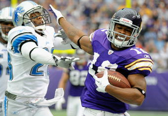 MINNEAPOLIS, MN - SEPTEMBER 25: Percy Harvin #12 of the Minnesota Vikings is forced out of bounds by Chris Houston #23 of the Detroit Lions on September 25, 2011 at Hubert H. Humphrey Metrodome in Minneapolis, Minnesota. (Photo by Hannah Foslien/Getty Ima