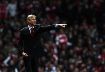 LONDON, ENGLAND - OCTOBER 25:  Arsenal manager Arsene Wenger gives his players instructions during the Carling Cup Fourth Round match between Arsenal and Bolton Wanderers at Emirates Stadium on October 25, 2011 in London, England.  (Photo by Dean Mouhtaro