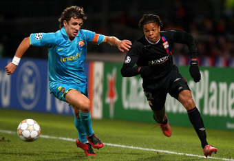 LYON, FRANCE - NOVEMBER 27:  Carles Puyol of Barcelona battles for possesion with Loic Remy of Lyon during the UEFA Champions League Group E match between Lyon and Barcelona at the Stade Gerland on November 27, 2007 in Lyon, France.  (Photo by Mike Hewitt