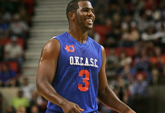 OKLAHOMA CITY, OK - OCTOBER 23:  Chris Paul of Team Blue walks down court during the US Fleet Tracking Basketball Invitational charity basketball game October 23, 2011 at the Cox Convention Center in Oklahoma City, Oklahoma.  The game benefitted the Singl