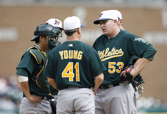 DETROIT- MAY 31: Pitching coach Curt Young #41 talks with Trevor Cahill #53 of the Oakland Athletics in the third inning during action against the Detroit Tigers on May 31, 2010 at Comerica Park in Detroit, Michigan. The Athletics defeated the Tigers 4-1.