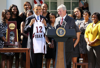 WASHINGTON, DC - OCTOBER 06:  U.S. President Barack Obama (L) is presented with a jersey by head coach Gary Blair (R) during a Rose Garden event to welcome the Texas A&M University Women's Basketball Team to the White House October 6, 2011 in Washington,