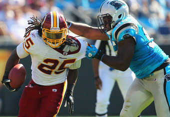Charles Johnson (95) brings down Redskins running back, Tim Hightower (25) in the Panthers' 33-20 win.