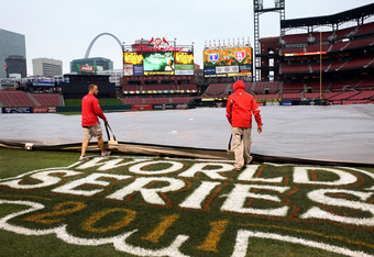 ST LOUIS, MO - OCTOBER 26:  Members of the field crew put the tarp on the field at Busch Stadium on October 26, 2011 in St Louis, Missouri. Game 6 of the World Series has been postposed by Major League Baseball because of rainy weather. The game has been