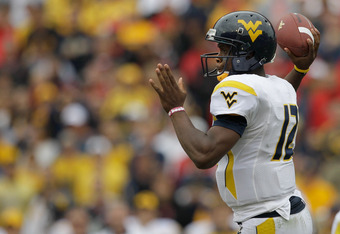 COLLEGE PARK, MD - SEPTEMBER 17: Quarterback Geno Smith #12 of the West Virginia Mountaineers drops back to pass against the Maryland Terrapins during the second half at Byrd Stadium on September 17, 2011 in College Park, Maryland. West Virginia defeated