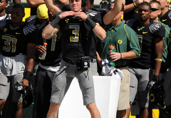 EUGENE, OR - SEPTEMBER 04:  Quarterback Bryan Bennett #3 of the Oregon Ducks signals in a play in front of the signal boards that the Ducks use to call plays during the game against the New Mexico Lobos at Autzen Stadium on September 4, 2010 in Eugene, Or