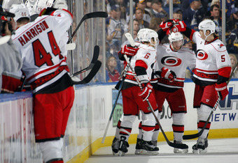 BUFFALO, NY - OCTOBER 14:  Tim Gleason #6, Jiri Tlusty #19 and Bryan Allen #5 of the Carolina Hurricanes celebrate a goal against the Buffalo Sabres during their NHL game at First Niagara Center October 14, 2011 in Buffalo, New York.  (Photo by Dave Sandf
