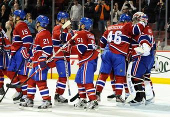 MONTREAL, CANADA - OCTOBER 26:  Members of the Montreal Canadiens celebrate their 5-1 victory over the Philadelphia Flyers and teammate Carey Price's #31 100th career victory during the NHL game at the Bell Centre on October 26, 2011 in Montreal, Quebec,