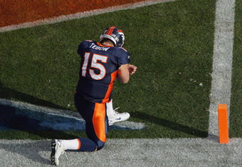 DENVER - DECEMBER 26:  Tim Tebow #15 of the Denver Broncos prays in the end zone prior to taking on the Houston Texans at INVESCO Field at Mile High on December 26, 2010 in Denver, Colorado. (Photo by Justin Edmonds/Getty Images)