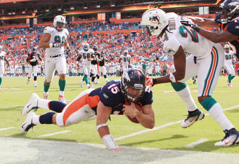 MIAMI GARDENS, FL - OCTOBER 23:  Quarterback Tim Tebow #15 of the Denver Broncos dives against the Miami Dolphins to end the game to overtime at Sun Life Stadium on October 23, 2011 in Miami Gardens, Florida. Denver defeated Miami 18-15.  (Photo by Marc S