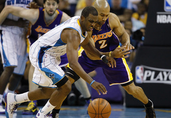 NEW ORLEANS - APRIL 24:  Chris Paul #3 of the New Orleans Hornets and Derek Fisher #2 of the Los Angeles Lakers scramble for a loose ball in Game Four of the Western Conference Quarterfinals in the 2011 NBA Playoffs at New Orleans Arena on April 24, 2011