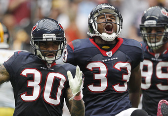 HOUSTON - OCTOBER 02:  Jason Allen #30 and Troy Nolan #33 of the Houston Texans celebrate after breaking up a pass intended for wide receiver Hines Ward #86 of the Pittsburgh Steelers at Reliant Stadium on October 2, 2011 in Houston, Texas. Houston won 17