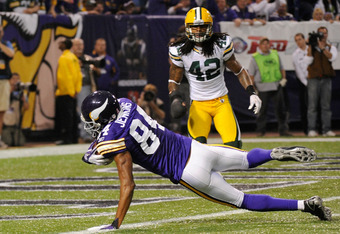 MINNEAPOLIS, MN - OCTOBER 23: Morgan Burnett #42 of the Green Bay Packers looks on as Michael Jenkins #84 of the Minnesota Vikings scores a touchdown in the fourth quarter on October 23, 2011 at Hubert H. Humphrey Metrodome in Minneapolis, Minnesota. The