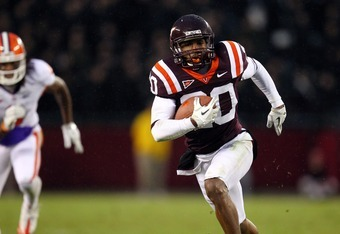 BLACKSBURG, VA - OCTOBER 1: Cornerback Jayron Hosley #20 of the Virginia Tech University Hokies returns the ball after an interception against the Clemson University Tigers on October 1, 2011 at Lane Stadium in Blacksburg, Virginia. (Photo by Ned Dishman/
